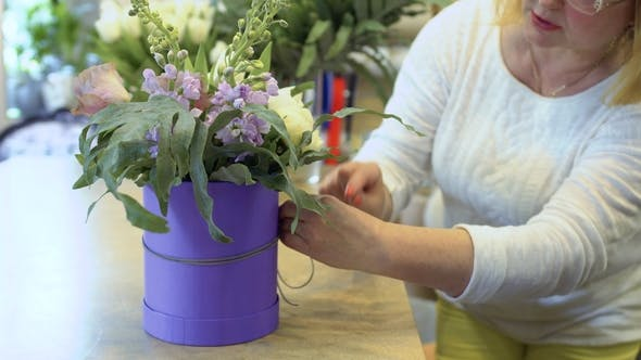 Thumbnail for Woman Tie Decorative Rope Around the Box with Flower Composition