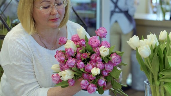 Thumbnail for Mature Woman Hold Bouquet of Roses and Tulips
