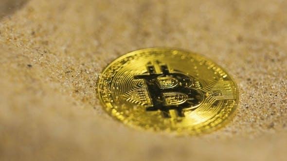 Thumbnail for Digitale Währung Bitcoin Modell gegossen mit Sand