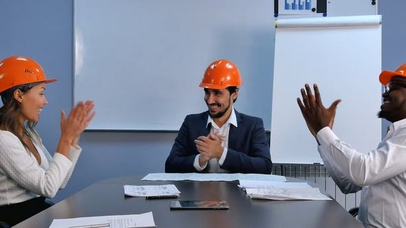 Thumbnail for Multiracial Team of Engineers Successful in Business Celebrating Success Shaking Hands and Smiling