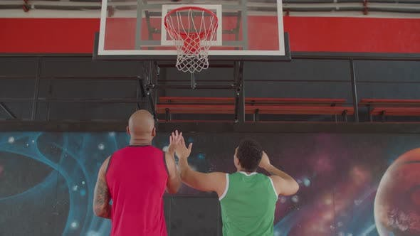 Rival Basketball Players Figthing for Rebound
