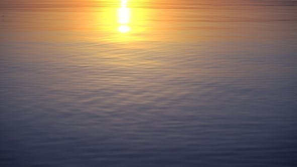 Thumbnail for Beautiful Sunset Reflects in Calm Water Surface