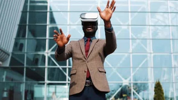 Thumbnail for African American Businessman Plays in VR Headset Standing Outside