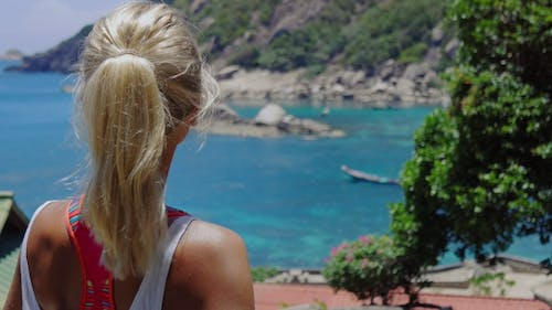 Tanned Sporty Looking Female Admire the Beautiful Tanote Bay on Midday Sunny Light. Slight Ocean