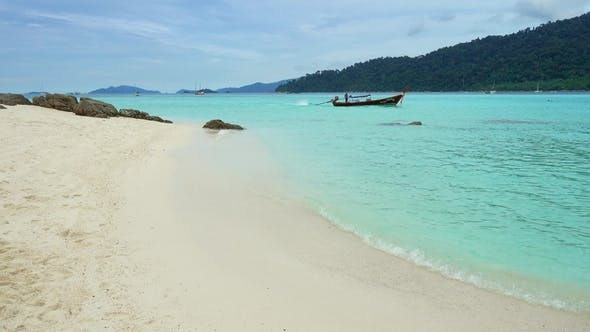 Thumbnail for White Sandy Beach and Boat in Sea on Koh Lipe