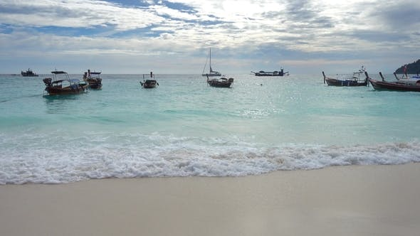 White Sandy Beach and Boats in Sea