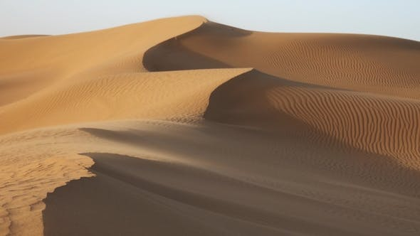 Thumbnail for Sand Blowing over Dunes in Wind at Sahara Desert