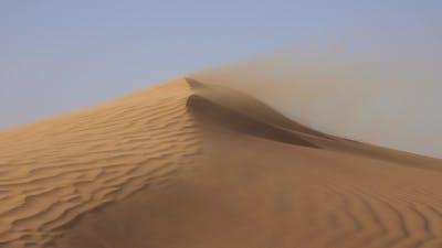 Sand Blowing in Sand Dunes in Wind, Sahara Desert
