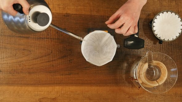 Thumbnail for Barista Pouring Water on Coffee Ground with Filter