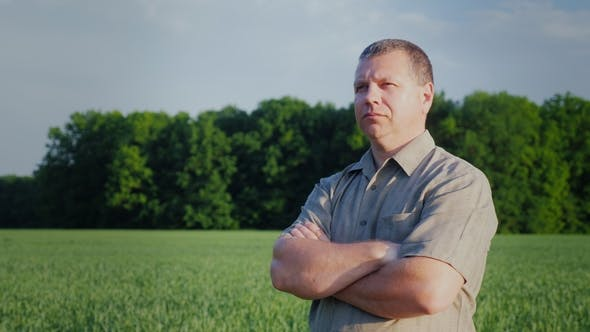 Thumbnail for Confident Middle-aged Farmer Standing in the Field. Master of Business Concept