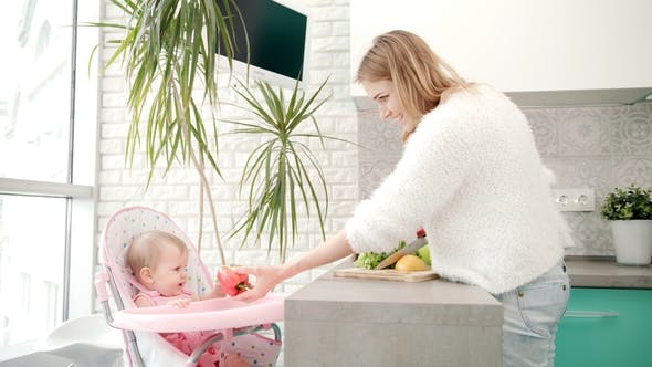 Thumbnail for Pretty Woman Cooking Healthy Food with Baby. Healthy Diet