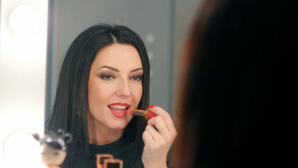 Thumbnail for Reflection of Lady Applying Her Make-up. Brunette Mature Woman Putting Lipstick