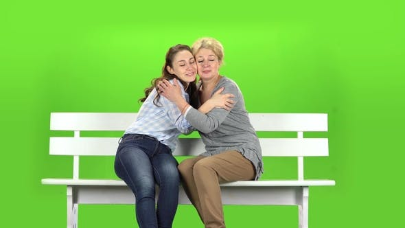 Thumbnail for Native To Embrace, They Are Sitting on a White Bench. Green Screen