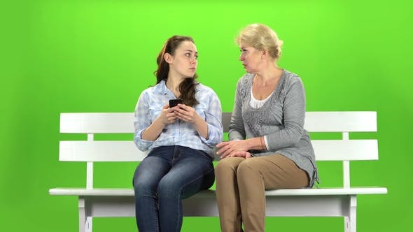 Thumbnail for Girl Shows Something in the Phone To Her Mother. Green Screen