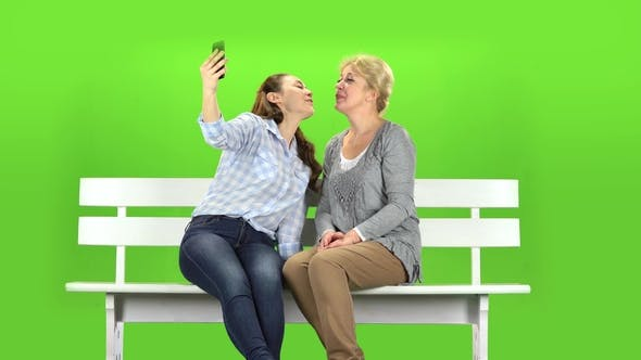 Thumbnail for Mom and Daughter Do Selfie. Green Screen