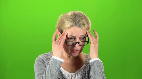 Thumbnail for Grandmother Suffers From a Headache. Green Screen