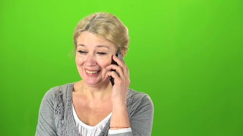 Housewife Speaks on the Phone