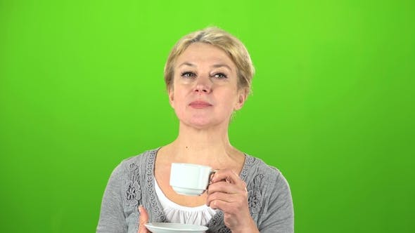 Thumbnail for Woman Is Drinking Tea