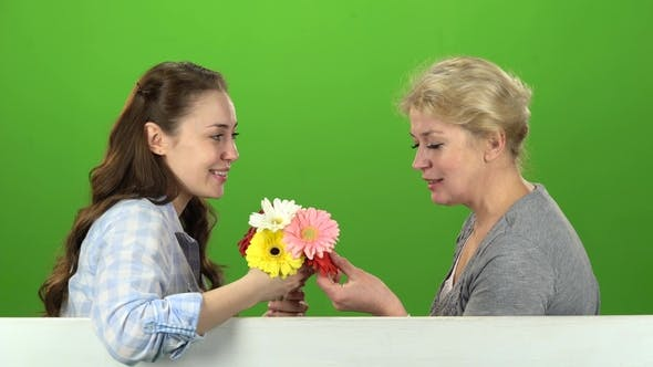 Thumbnail for Girl with Her Mother Is Sniffing a Bouquet of Flowers