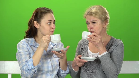 Thumbnail for Two Women Drink Tea and Talk