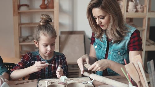 Family Hobby. Mother and Child Are Engaged in Clay Modeling