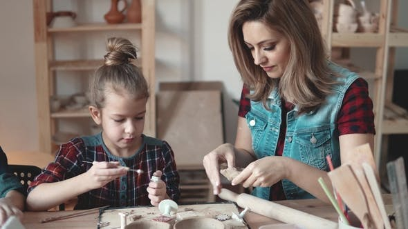Thumbnail for Family Hobby. Mother and Child Are Engaged in Clay Modeling