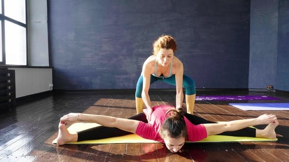 Thumbnail for Women Stretching and Relaxing in Yoga Class