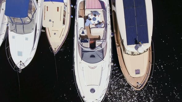 Thumbnail for Three Men Convinietly Located at the Deck of Yacht and Prepare To Cruise