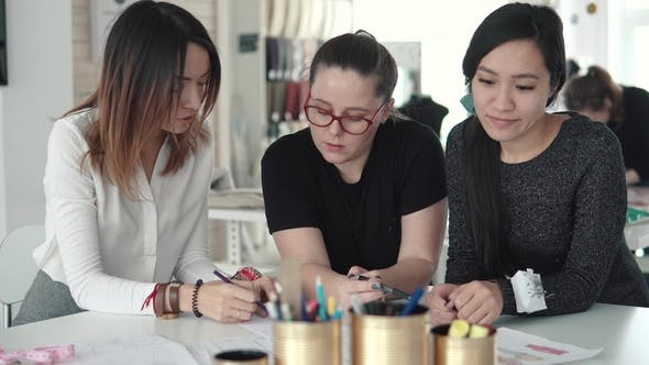 Thumbnail for Group of Business Woman Working on a Startup of a Small Atelier. Several Fashion Designers Discuss