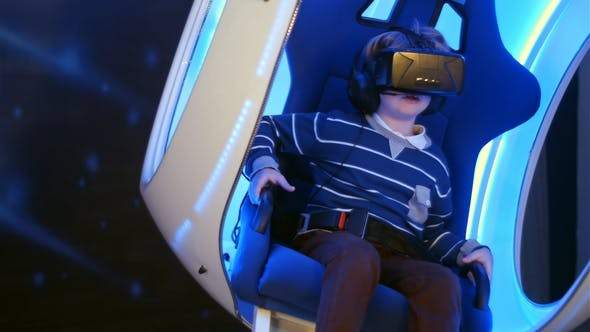 Cover Image for Little Boy Experiencing Virtual Reality Sitting in Interactive Moving Chair