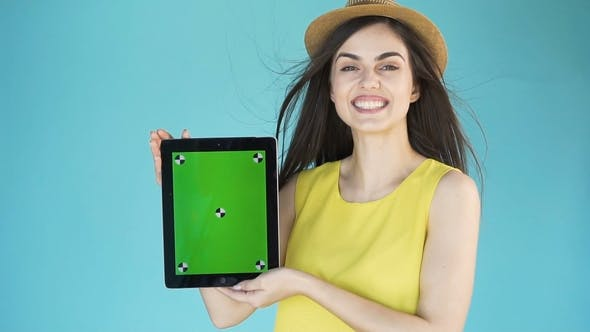 Thumbnail for Smiling Woman with Tablet