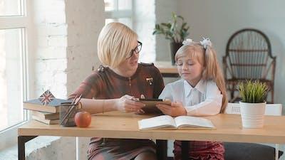 Teacher Teaches with Tablet
