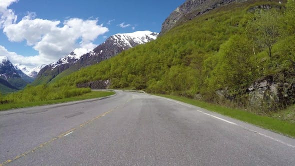 Thumbnail for Driving a Car on a Serpentine Road in Norway