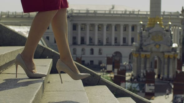 Thumbnail for Female Legs in High Heels Stepping Down on Stairway