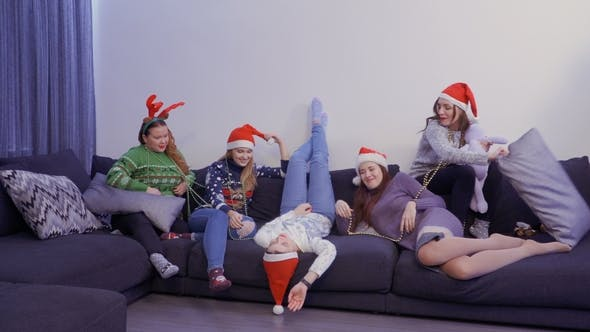 Thumbnail for Five Girls Have Fun at Sofa at Home, on the Eve of Christmas