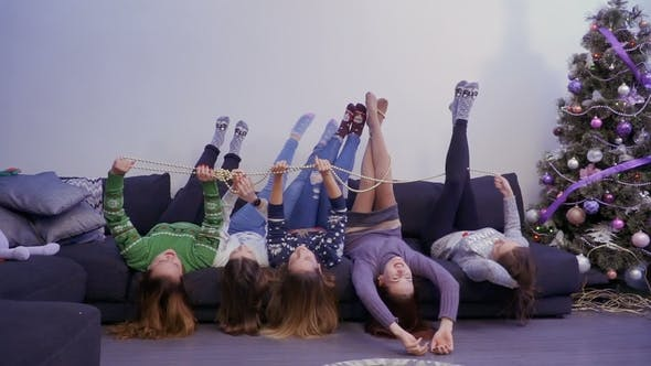 Thumbnail for Young and Carefree Girls Lies on Sofa Upside Down and Have Fun