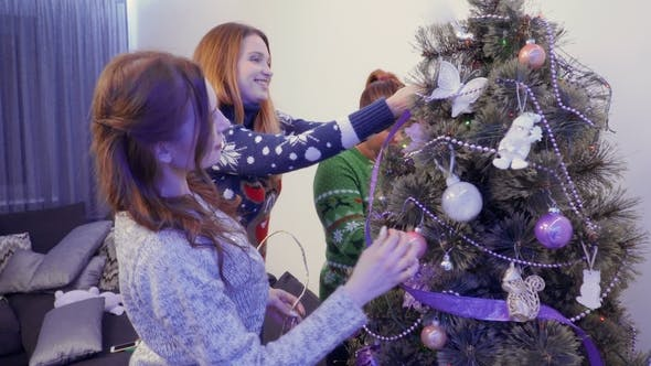 Thumbnail for Young Girls Decorate Christmas Tree