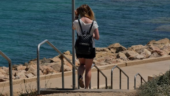 Thumbnail for Young Girl Walking Down the Stairs To the Sea