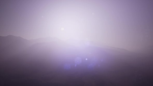 Cover Image for Aerial Green Hills Landscape in Fog