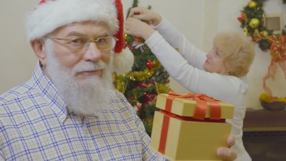Thumbnail for Senior Man Wearing Santa Hat Want To Make Suprise for His Wife