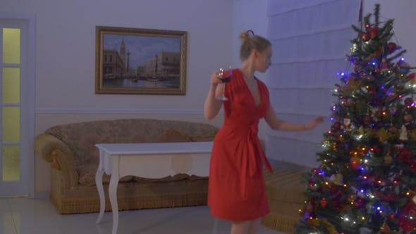 Thumbnail for Confident and Beautiful Woman in Red Dress Celebrate Christmas Alone at Home