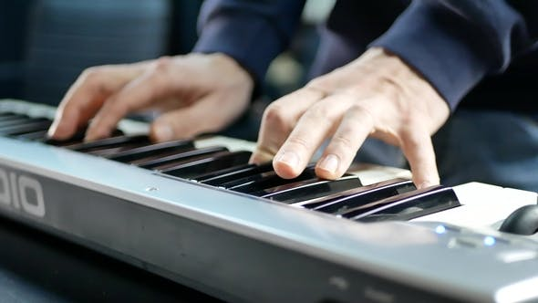 Thumbnail for Pianist's Hand Plays on the Electronic Piano