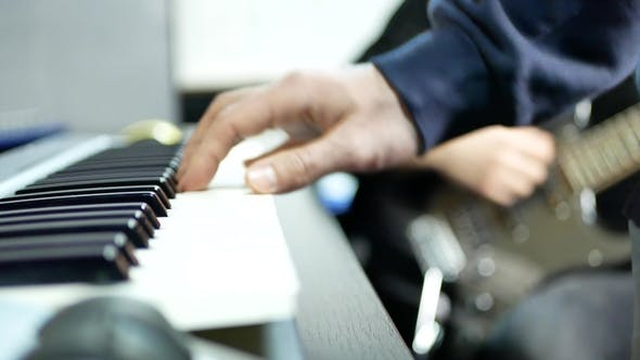 Thumbnail for Band Musicians Playing Piano and Guitar Against