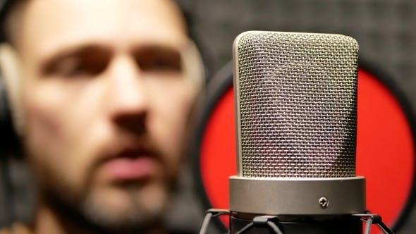 Thumbnail for Singer Man in Recording Studio Dresses Headphones