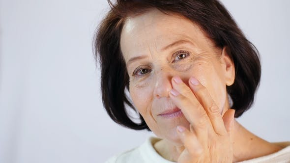 Thumbnail for Middle-aged Woman Applying Cream