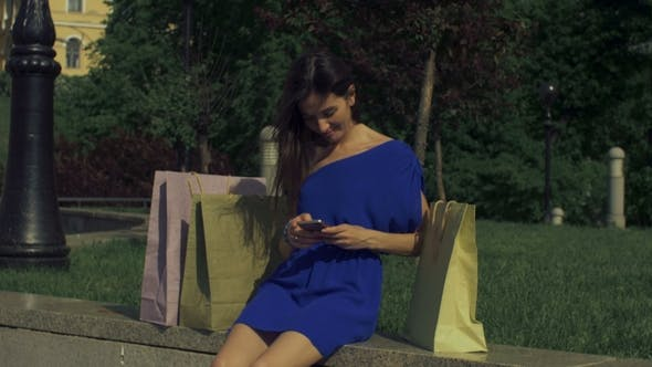Thumbnail for Carefree Shopper Woman Using Smart Phone in the City