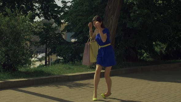Thumbnail for Elegant Woman Twisting Her Ankle While Walking on Street