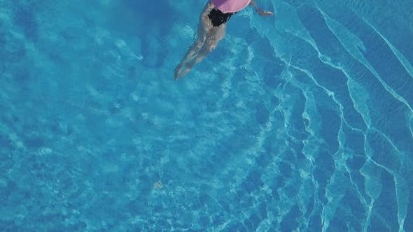 Thumbnail for Young Woman Swimming in a Swimming Pool