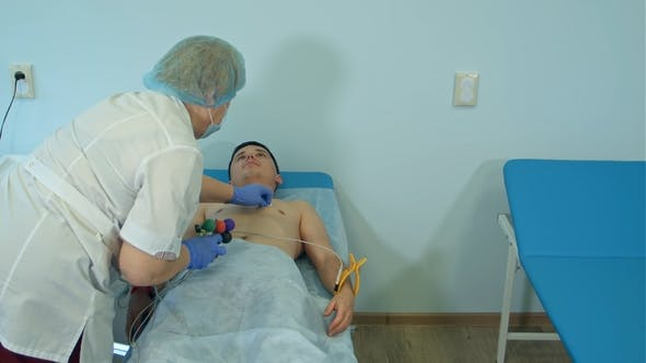 Thumbnail for Nurse Preparing Patient's Chest To Attach Electrode Pads for ECG