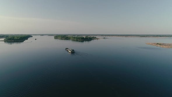 Cover Image for Aerial Drone footage.Following Barge in Calm Water